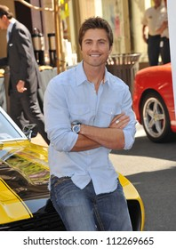 """LOS ANGELES, CA - MARCH 31, 2009: Eric Winter at press event to launch """"The Rally for Kids with Cancer Scavenger Cup"""" at The Americana at Brand Shopping Centre, Glendale"""