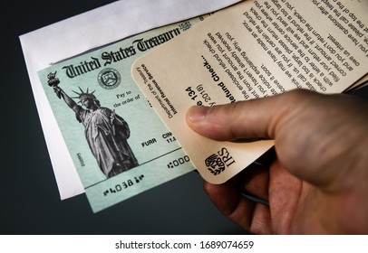 Los Angeles, CA - March 31, 2020:  United States Department of Treasury issued Internal Revenue Service refund checks for income tax.  Also an illustration for US economic impact stimulus payment.