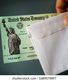 LOS ANGELES, CA - MARCH 31. 2010: United States Treasury check with an envelope. Illustration for stimulus checks to ease the financial impact of Coronavirus (Covid-19) restrictions or IRS tax refund.