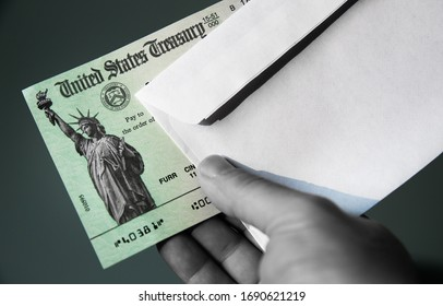 LOS ANGELES, CA - MARCH 31, 2020: United States Treasury check with envelope. Illustration for economic impact stimulus payments to ease the financial burden of Coronavirus (Covid-19) on US economy.