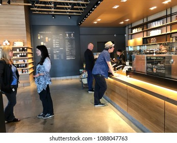 Los Angeles, CA: May 10, 2018: Starbucks Reserve customers inside a Los Angeles Starbucks Reserve store. Starbucks has plans to open several hundred Starbucks Reserve stores in the world.
