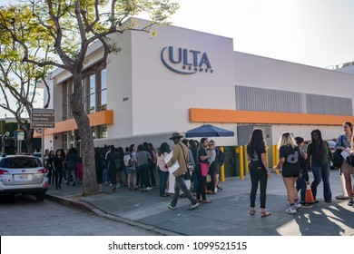 Los Angeles, CA: May 17, 2018: Young women waiting in line to enter an ULTA store in Los Angeles.  ULTA was founded in 1990.