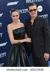 "LOS ANGELES, CA - MAY 29, 2014: Angelina Jolie & Brad Pitt at the world premiere of her movie ""Maleficent"" at the El Capitan Theatre, Hollywood."