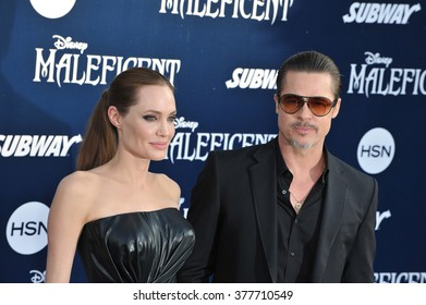 """LOS ANGELES, CA - MAY 29, 2014: Angelina Jolie & Brad Pitt at the world premiere of her movie """"Maleficent"""" at the El Capitan Theatre, Hollywood."""