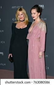 LOS ANGELES, CA - November 04, 2017: Melanie Griffith & Dakota Johnson at the 2017 LACMA Art+Film Gala at the Los Angeles County Museum of Art,