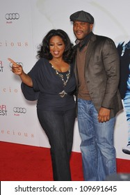 """LOS ANGELES, CA - NOVEMBER 1, 2009: Oprah Winfrey & Tyler Perry at the Los Angeles premiere of their new movie """"Precious"""" at Grauman's Chinese Theatre, Hollywood."""