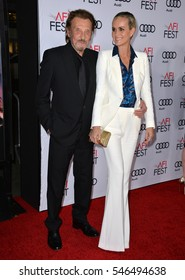 "LOS ANGELES, CA. November 10, 2016: French actor/singer Johnny Hallyday & actress wife Laeticia Hallyday at premiere of ""Rules Don't Apply"" at the TCL Chinese Theatre"