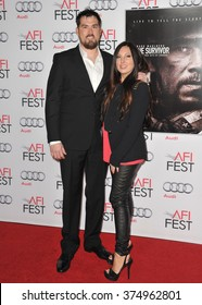 "LOS ANGELES, CA - NOVEMBER 12, 2013: Retired Petty Officer 1st Class Marcus Luttrell & wife at the world premiere of the movie based on his story ""Lone Survivor"" at the TCL Chinese Theatre, Hollywood."