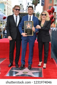 LOS ANGELES, CA. November 16, 2018: Michael Buble, Lewis Buble & Amber Santaga Buble at the Hollywood Walk of Fame Star Ceremony honoring singer Michael Bublé.Pictures: Paul Smith/Featureflash