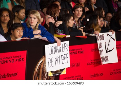 LOS ANGELES, CA - NOVEMBER 18: Fans attend the premiere of The Hunger Games: Catching Fire at the Nokia Theater in Los Angeles, CA on November 18, 2013