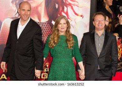 LOS ANGELES, CA - NOVEMBER 18: Writers Suzanne Collins, Simon Beaufoy and Michael Arndt arrive at the premiere of The Hunger Games: Catching Fire in Los Angeles, CA on November 18, 2013