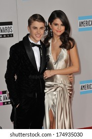 LOS ANGELES, CA - NOVEMBER 20, 2011: Justin Bieber & Selena Gomez arriving at the 2011 American Music Awards at the Nokia Theatre, L.A. Live in downtown Los Angeles.