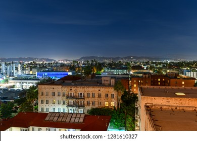 Los Angeles, CA - November 23, 2018: Aerial view of the Los Angeles skyline at night looking towards Hollywood Hills in California.