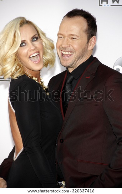 LOS ANGELES, CA - NOVEMBER 23, 2014: Jenny McCarthy and Donnie Wahlberg at the 2014 American Music Awards held at the Nokia Theatre L.A. Live in Los Angeles on November 23, 2014.