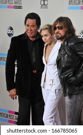LOS ANGELES, CA - NOVEMBER 24, 2013: Miley Cyrus & father Billy Ray Cyrus with Wayne Newton (left) at the 2013 American Music Awards at the Nokia Theatre, LA Live.
