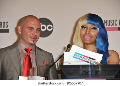 LOS ANGELES, CA - OCTOBER 11, 2011: Nicki Minaj & Pitbull at the nominations announcement for 2011 American Music Awards at the JW Marriott Los Angeles at LA Live October 11, 2011  Los Angeles, CA