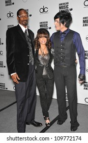 LOS ANGELES, CA - OCTOBER 13, 2009: Snoop Dogg (left), Paula Abdul & Adam Lambert at the nominations announcement for the 2009 American Music Awards at the Beverly Hills Hotel.