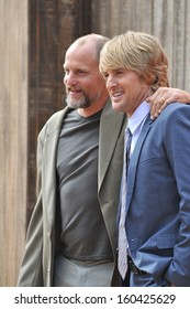 """LOS ANGELES, CA - OCTOBER 13, 2013: Woody Harrelson & Owen Wilson (right) at the world premiere of their movie """"Free Birds"""" at the Westwood Village Theatre."""