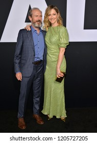 """LOS ANGELES, CA. October 17, 2018: Judy Greer & Toby Huss at the premiere for """"Halloween"""" at the TCL Chinese Theatre."""