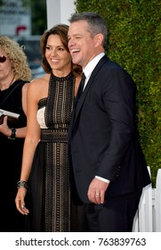 """LOS ANGELES, CA - October 22, 2017: Matt Damon & Luciana Barroso at the premiere for """"Suburbicon"""" at the Regency Village Theatre, Westwood"""