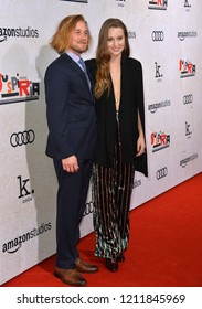 """LOS ANGELES, CA. October 24, 2018: Lou Taylor Pucci & Camille Kane at the Los Angeles premiere for """"Suspiria"""" at the Cinerama Dome.Picture: Paul Smith/Featureflash"""