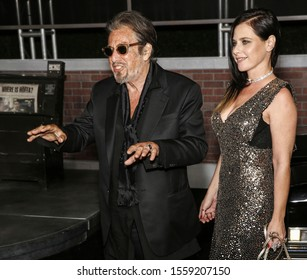 """Los Angeles, CA - October 24, 2019: Al Pacino and Meital Dohan arrive for the Premiere Of Netflix's """"The Irishman"""" held at TCL Chinese Theatre"""
