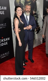 "LOS ANGELES, CA. October 24, 2016: Director Mel Gibson & girlfriend Rosalind Ross at the Los Angeles premiere of ""Hacksaw Ridge"" at The Academy's Samuel Goldwyn Theatre, Beverly Hills."