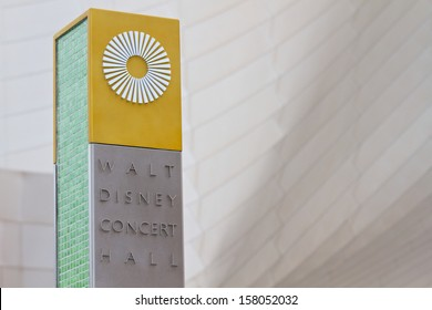 LOS ANGELES, CA - OCTOBER 9: The Walt Disney Concert Hall sign close up, with detail of building's architecture behind August, 9 2013 in Los Angeles, California.  The concert hall seats 2265 people.