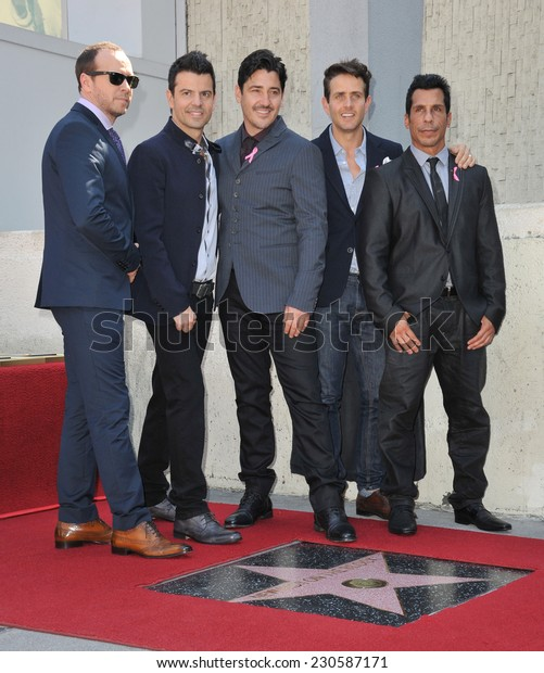 LOS ANGELES, CA - OCTOBER 9, 2014: New Kids On The Block - Jordan Knight, Jonathan Knight, Donnie Wahlberg, Joey McIntyre & Danny Wood - at the unveiling of their star on the Hollywood Walk of Fame.
