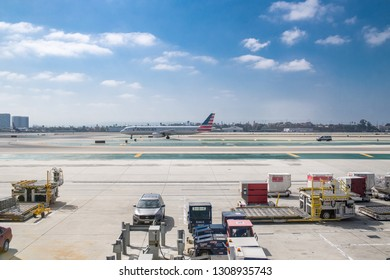 Los Angeles, CA: September 11, 2018:   Los Angeles International Airport with planes on the tarmac. Los Angeles International Airport is one of the busiest airports in the world.