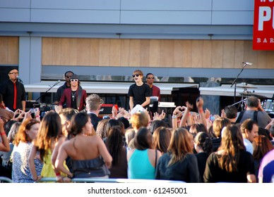 LOS ANGELES, CA- SEPTEMBER 12: Canadian singer Justin Bieber (black center) performs at the MTV video awards 2010 outside Nokia Theater, September 12, 2010 in Los Angeles.