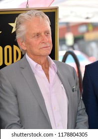 """LOS ANGELES, CA. September 13, 2018: Michael Douglas at the Hollywood Walk of Fame Star Ceremony honoring """"Will & Grace"""" star Eric McCormack."""