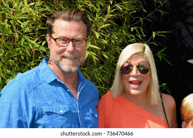 """LOS ANGELES, CA - September 16, 2017: Tori Spelling & Dean McDermott at the premiere for """"The Lego Ninjago Movie"""" at the Regency Village Theatre, Westwood"""