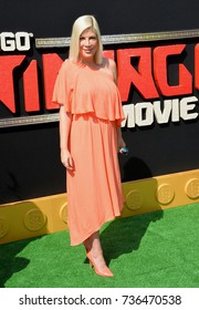"""LOS ANGELES, CA - September 16, 2017: Tori Spelling at the premiere for """"The Lego Ninjago Movie"""" at the Regency Village Theatre, Westwood"""