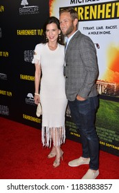 "LOS ANGELES, CA. September 19, 2018: Perrey Reeves & Aaron Endress-Fox at the Los Angeles premiere for Michael Moore's ""Fahrenheit 11/9"" at the Samuel Goldwyn Theatre."