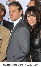 """LOS ANGELES, CA - SEPTEMBER 7, 2013: Charlie Hunnam & Katey Sagal at the season 6 premiere of """"Sons of Anarchy"""" at the Dolby Theatre, Hollywood."""