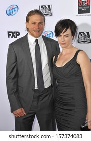 """LOS ANGELES, CA - SEPTEMBER 7, 2013: Charlie Hunnam & Maggie Siff at the season 6 premiere of """"Sons of Anarchy"""" at the Dolby Theatre, Hollywood."""