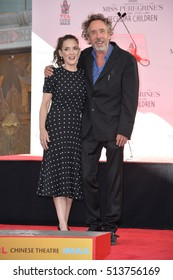 LOS ANGELES, CA. September 8, 2016: Director Tim Burton & actress Winona Ryder at the TCL Chinese Theatre, Hollywood, where he had his hand and footprints set in cement in the forecourt of the theatre