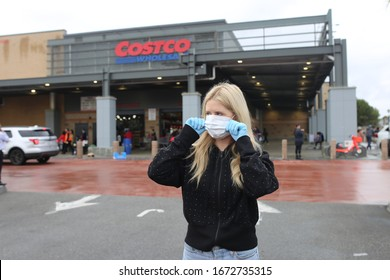 Los Angeles, CA / USA - 03.13.2020: woman wearing face mask and gloves, costco grocery store, coronavirus, covid 19, virus protection