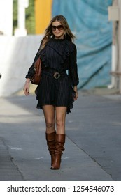 Los Angeles, CA, USA, 12-10-2006 Carmen Electra out and about in blue pinstriped dress and brown boots.