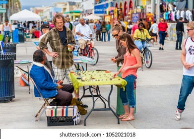 Los Angeles, CA, USA - April 1, 2013: Market vendors and people at the famous Venice Beach Boardwalk in California, USA.