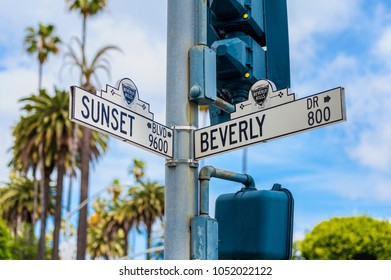 Los Angeles, CA, USA - April 1, 2013: Sunset Boulevard and Beverly Drive Street Signs in Beverly Hills, Los Angeles, California, USA.