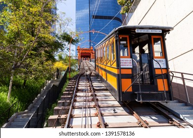 Los Angeles, CA. / USA - April 1, 2019: Historical tourist attraction site, Angel's Flight ascending up the hill in downtown LA business district
