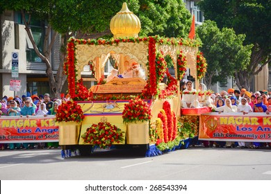 Los Angeles, CA, USA - April 5, 2015: Devotee Sikhs marching behind a float at the Anniversary of Baisakhi celebration.