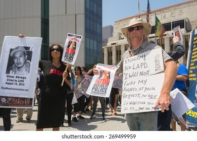 Los Angeles, CA, USA - April 14, 2015:  People holding signs during Stop Murder by Police.