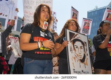 Los Angeles, CA, USA - April 14, 2015:  Women blowing whistles during Stop Murder by Police.