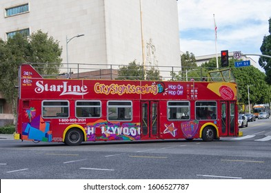 LOS ANGELES, CA, USA — December 30 2019: Empty Star Line double decker Hop On Hop Off sightseeing bus in Los Angeles Downtown.