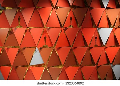 """Los Angeles, CA / USA - Feb. 24, 2019: The red """"step and repeat"""" photo background from the 2018 Academy Awards ceremony is shown on display inside the Oscars pop-up store in Hollywood."""