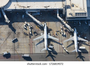 Los Angeles, CA / USA - February 15 2020: United Airlines terminal at LAX International Airport, a focus city for United with flight connections. Boeing 737 and Airbus A320. Ground handling equipment.