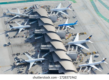 Los Angeles, CA / USA - February 15 2020: Aerial view of Tom Bradley International Terminal concourse at LAX airport. Busy passengers concourse with aircraft from airlines from around the world.